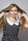 Young long-haired curly blonde woman Royalty Free Stock Images
