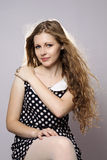 Young long-haired curly blonde woman Stock Photography