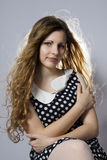 Young long-haired curly blonde woman Royalty Free Stock Photo