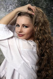 Young long-haired curly blonde woman Stock Image