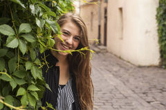 Young long-haired lady portrait the street. Walk. Stock Images