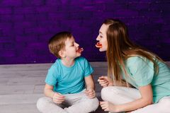 Young long-haired mother and seven year old have fun royalty free stock images