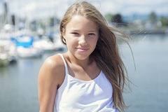 Young long-haired teen girl standing on the beach Stock Photography