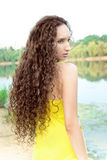 Young long-haired woman on beach royalty free stock photos