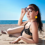 Young long-haired woman on the beach Stock Photo