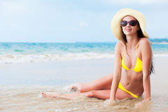Young long haired woman in bikini in sunglasses Royalty Free Stock Image