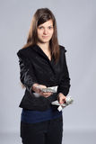 Young long-haired woman holding money. Young long-haired woman holding dollars and offered money Royalty Free Stock Images
