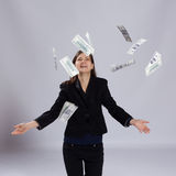 Young long-haired woman throw money. Young long-haired woman throws dollars up to Royalty Free Stock Images