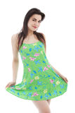 Young long haired woman wearing green dress, pose Royalty Free Stock Photography