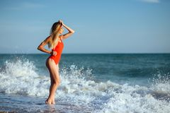 Young longhaired girl in red swimsuit Stock Photography