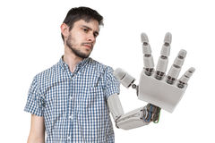 Young is looking at his robotic hand. Isolated on white background. 3D rendered illustration of hand.  Royalty Free Stock Image