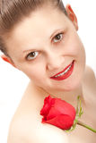 Young looking woman with red rose. White background Royalty Free Stock Photos