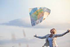 Young Lost Woman Losing a Map Because of the Wind Stock Photo