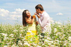 Young love. Young couple spends time outdoors Stock Photos