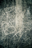 Young Love. A cement wall in Seoul, Korea with many couple's names scratched into it, along with hearts Stock Photo