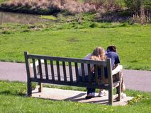 Young love 2. Young couple in love sitting on a park bench Royalty Free Stock Images