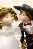 Young Love 2. Another view of two dolls dressed up in handmade wedding attire with a rose boquet Royalty Free Stock Images
