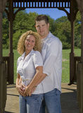 Young Love. A young couple posing in a gazebo Stock Photos