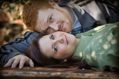 Young and in love. Engaged couple looking at camera Royalty Free Stock Photos