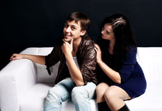 Young love couple. Smiling in the comfortable apartment Royalty Free Stock Photos