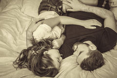 Young love couple in bed. Romantic scene in bedroom. Black and white shot Stock Images