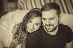 Young love couple in bed. Romantic scene in bedroom. Black and white shot Royalty Free Stock Photo