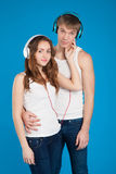 Young love couple. Boy holding girl. wearing headphones, listeni Stock Image