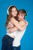 Young love couple. Boy holding girl. wearing headphones Stock Image