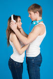 Young love couple. Boy putting on headphones, listening music in Royalty Free Stock Photo
