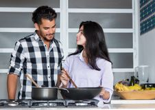 Young love couple cooking at kitchen Royalty Free Stock Photo
