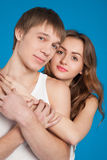 Young love couple holding each other in the studio Royalty Free Stock Photos