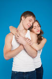 Young love couple holding each other in the studio Stock Photography