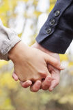 Young Love - Couple holding hands Royalty Free Stock Photography