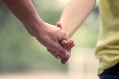 Young love couple holding hands and walk together. In vintage color tone Royalty Free Stock Photography