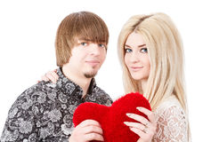 Young love couple holding red valentine's heart Stock Photo