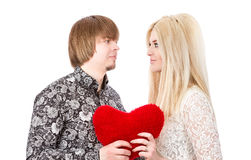 Young love couple holding red valentine's heart Stock Image