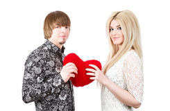 Young love couple holding red valentine's heart Stock Photos