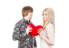 Young love couple holding red valentine's heart Royalty Free Stock Image
