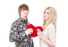 Young love couple holding red valentine's heart Royalty Free Stock Photography