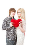 Young love couple holding red valentine's heart Royalty Free Stock Photo