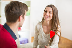 Young love couple holding red valentine's heart together. Royalty Free Stock Photo