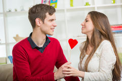Young love couple holding red valentines heart together. Stock Photography