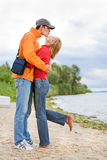 Young love Couple kissed on on coast of river royalty free stock photo