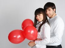 Young love couple with red balloons Stock Photography