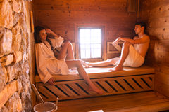 Young love couple relaxing in sauna stock photos