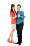 Young love couple showing thumbs up. Isolated on white background Stock Photography