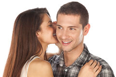 Lovely couple. Girl whispering her boy Royalty Free Stock Photos