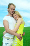 Young love couple smiling in field Stock Images