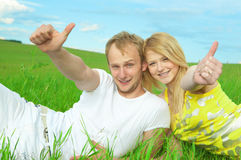 Young love couple smiling in field Royalty Free Stock Photo