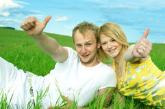 Young love couple smiling in field Royalty Free Stock Photos